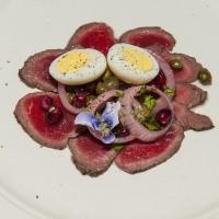 Venison Carpaccio with Farm Egg, Capers, Pomegranate Seeds, Onion