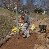 Chef Stuart working the soil of Newmans organic garden